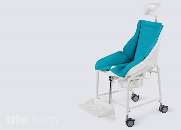 TS-Schale with headrest, padded upholstery and parallelogram footrest