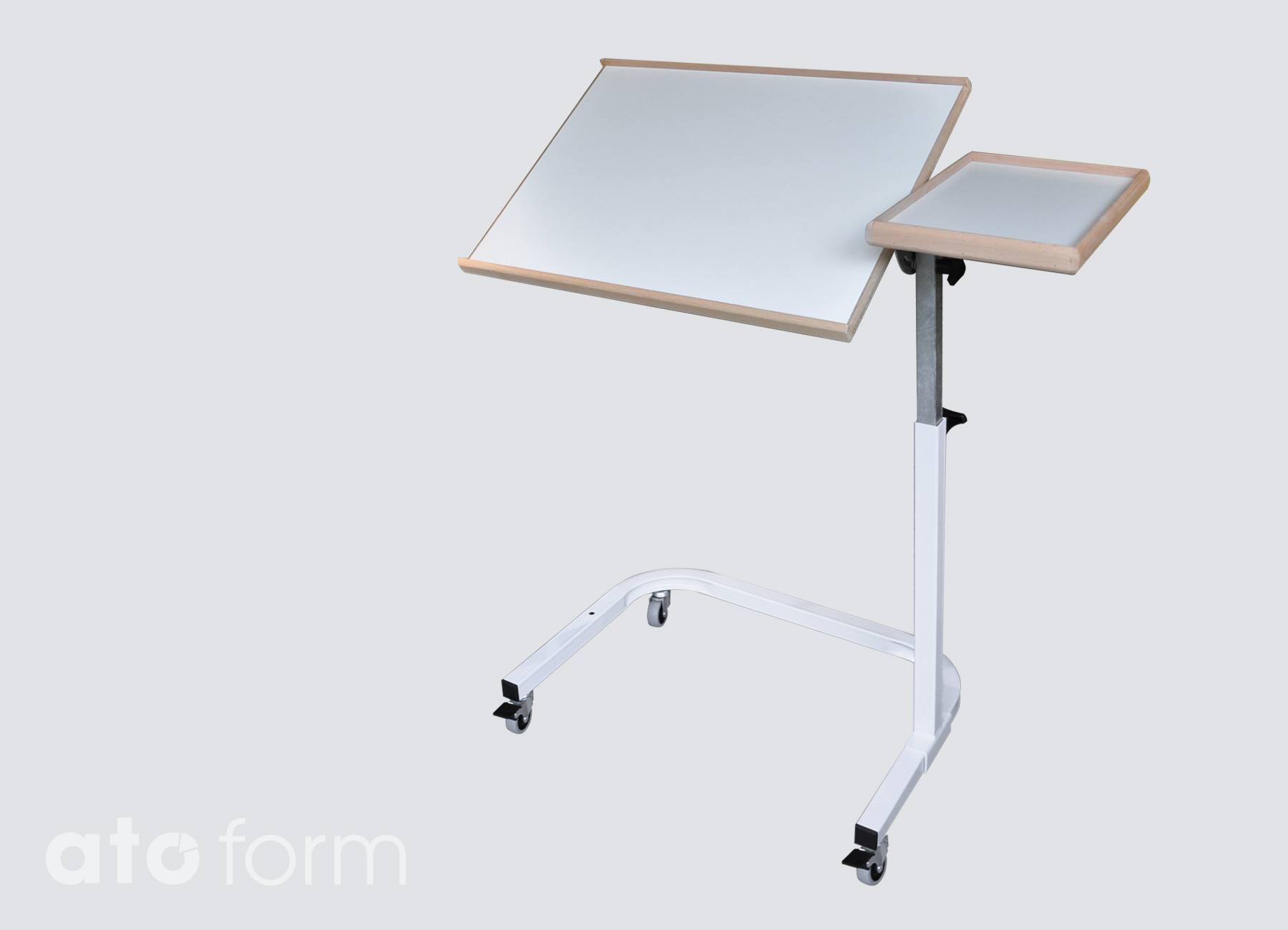 Bed-Table Saale with inclinable tabletop and fixed side-plate.
